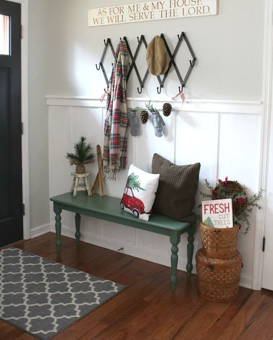 place a couple of baskets and a pinecone garland to make the entryway winter-like