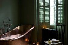 22 vintage bathroom with a copper bathtub and green walls