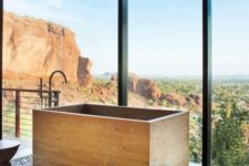 22 wooden soaking bathtub with a view