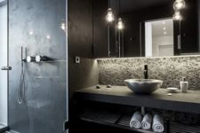 23 black modern bathroom with a concrete countertop and a tiled shower