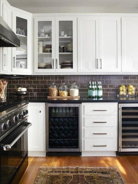 Chocolate Brown Subway Tiles Look Chic With Black Stone Countertops And White Cabinetry