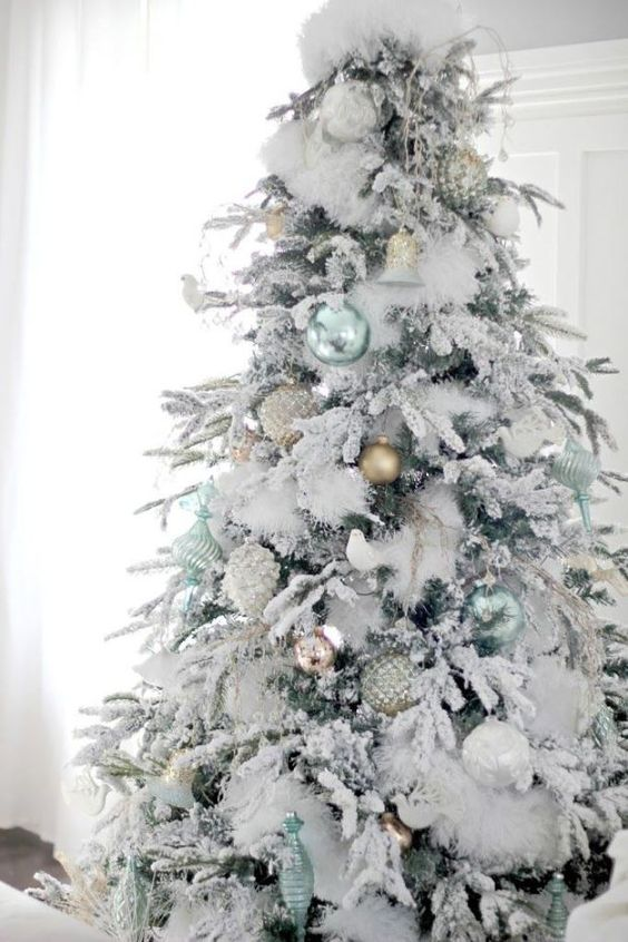 fluffy snowy tree with pastel ornaments