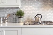 23 mother-of-pearl penny tile backsplash will reflect the light