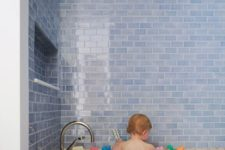 23 watery blue subway tiles and a terrazzo bath look so contrasting and cool together