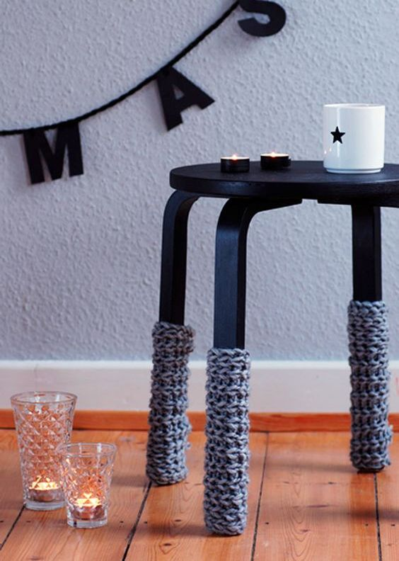 Frosta stool painted black and with crochet leg covers to embrace the winter