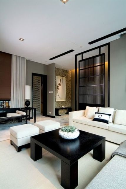 Zen interior with a black bamboo screen for separating zones