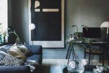 24 grey walls, a navy sofa and a modern large scale artwork