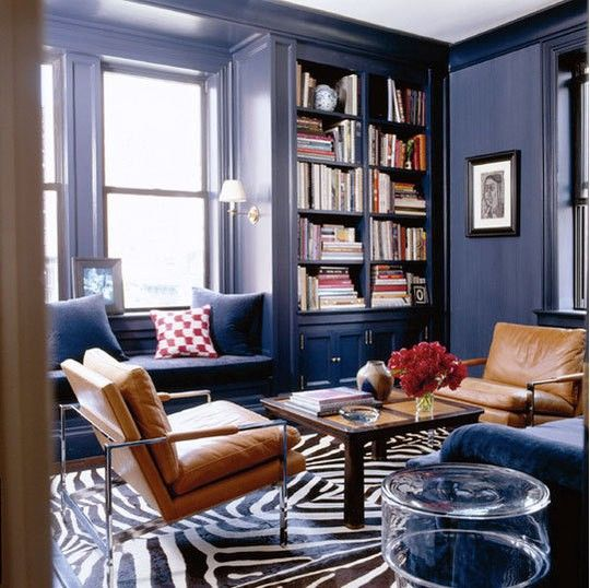 Royal Blue Living Room With Rich Brown And Creamy Accents Navy Space Tan Leather Chairs A Coffee Table