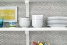 24 neutral grey penny tiles look cool with colorful tableware