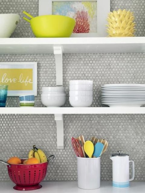 neutral grey penny tiles look cool with colorful tableware