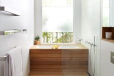 25 cover a usual soaking tub with wood and the shower space also to achieve that Japanese-inspired look