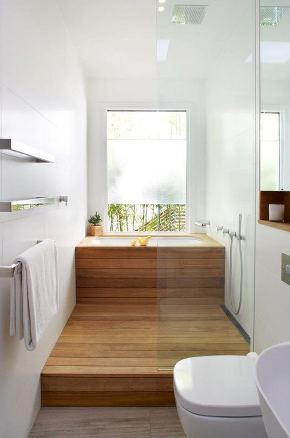 cover a usual soaking tub with wood and the shower space also to achieve that Japanese-inspired look
