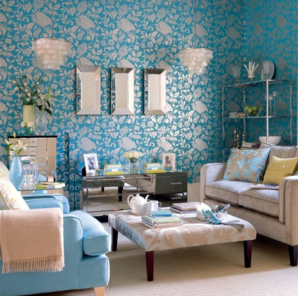 damask print wallpaper, beige upholstery and bright blue accessories