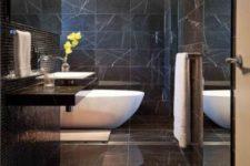 25 luxurious black marble bathroom with a white bathtub
