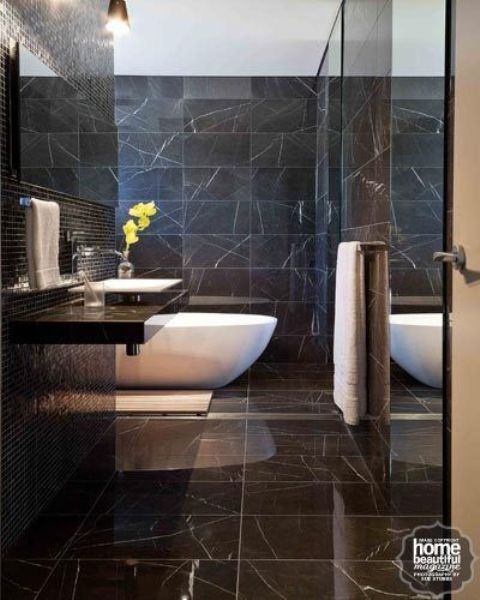 luxurious black marble bathroom with a white bathtub