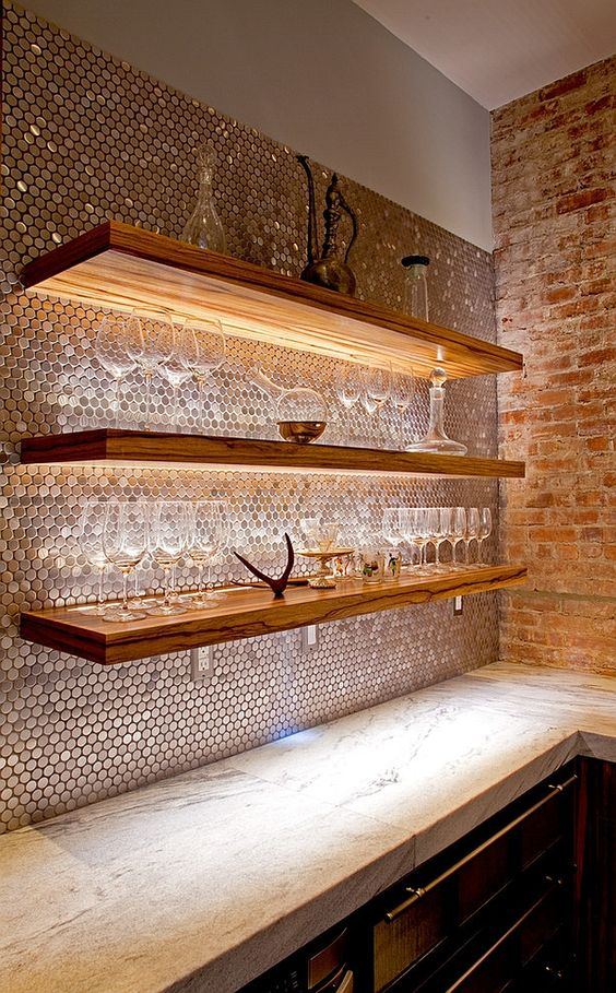 smart lighting to highlight architextural features, penny tiles reflect the light