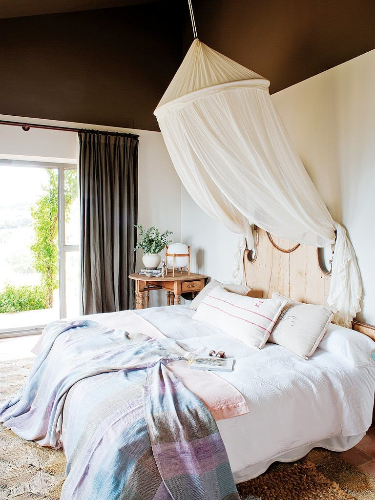 the bed look mush more inviting with a decorative canopy over it