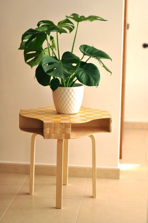 Ikea FROSTA stool, Ikea NASUM basket and you got yourself a very stylish plant stand with storage