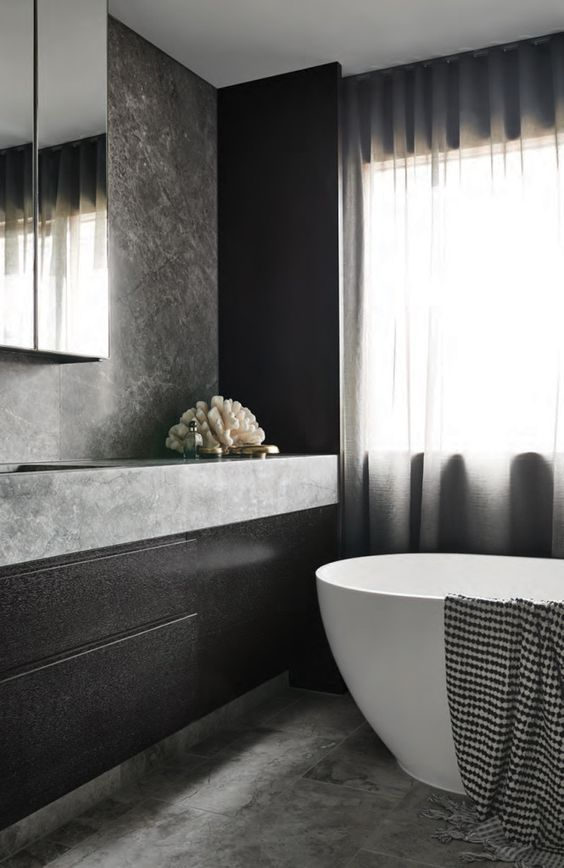 minimalist bathroom decor with dark wood, grey marble