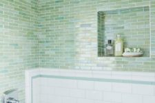26 small subway tiles in different shades of green