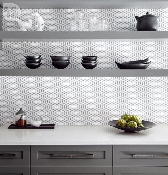 this modern kitchen looks stylish white penny tiles and grey sleek shelves