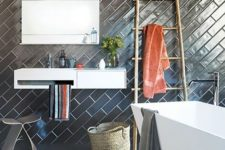 27 black subway tiles clad in diagonal pattern