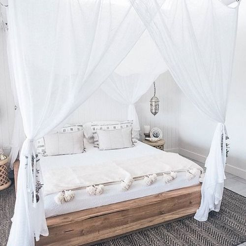 boho-inspired bedroom with crispy white curtains
