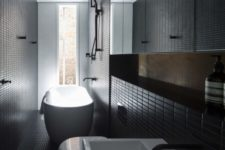 27 modern black bathroom clad with small tiles that add the space eye-catchy