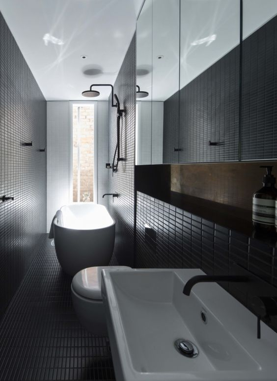 modern black bathroom clad with small tiles that add the space eye-catchy