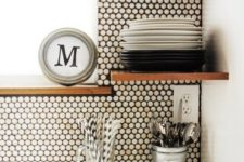 27 white penny tiles and black grout are the best ones to add texture to a minimalist black and white kitchen