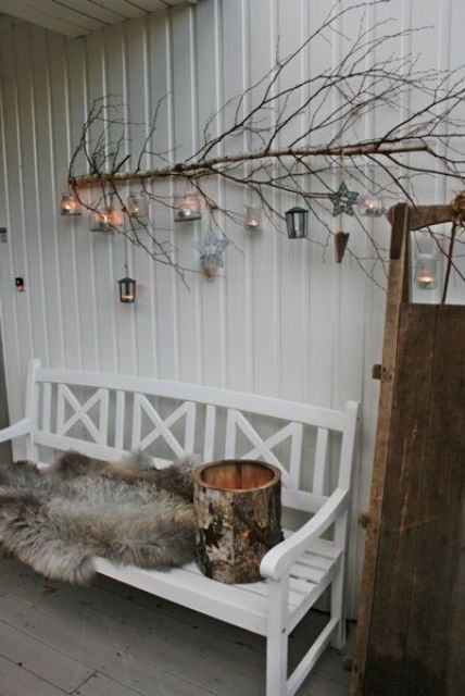 attach a branch with lanterns on the wall and add a fur throw