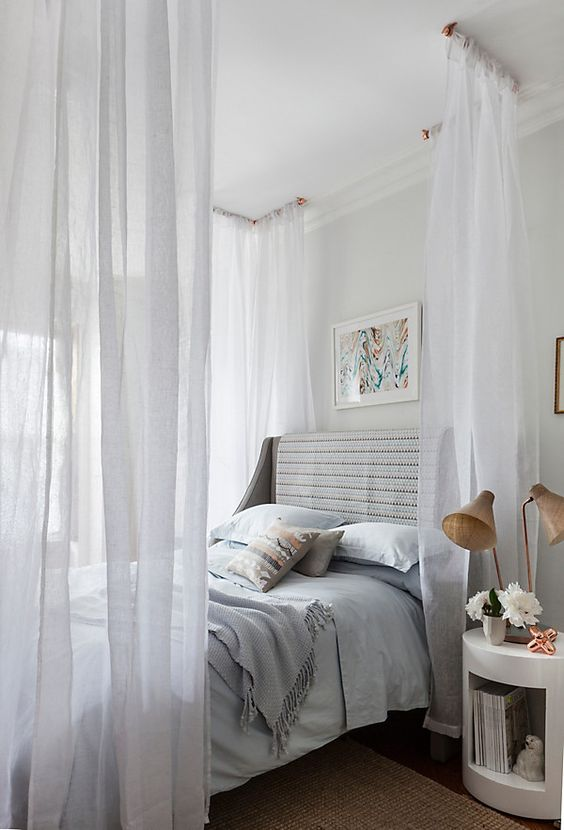 dreamy canopy over the bed looks very romantic