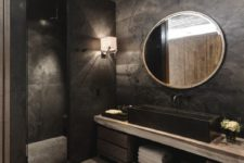 28 moody bathroom with a huge sink, wooden floor and cabinets