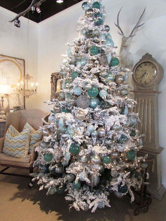 snow white tree with aqua and silver ornaments