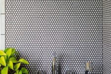 28 white penny tiles with black grout will add texture to your decor