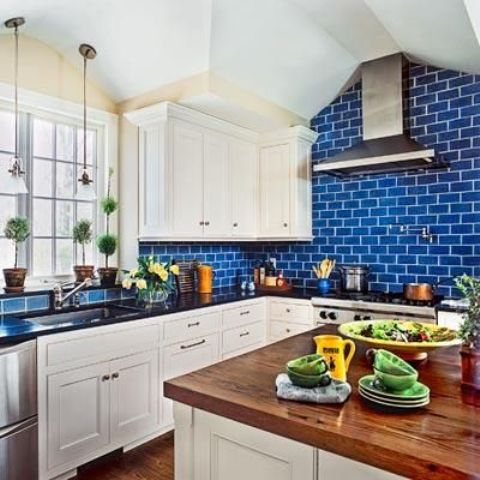 bold blue subway tiles to make the cabinetry look fresher