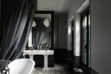29 moody vintage bathroom with white sinks and a bathtub, vintage furniture makes up the space