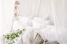 29 rustic bedroom with crispy white draperies over the bed