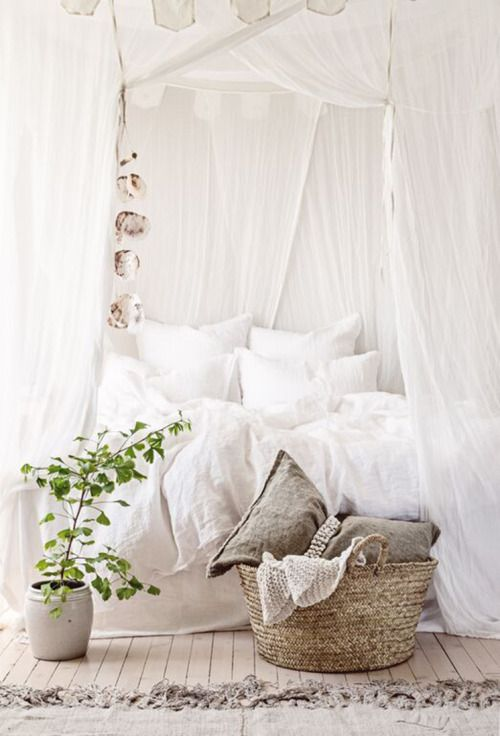 rustic bedroom with crispy white draperies over the bed
