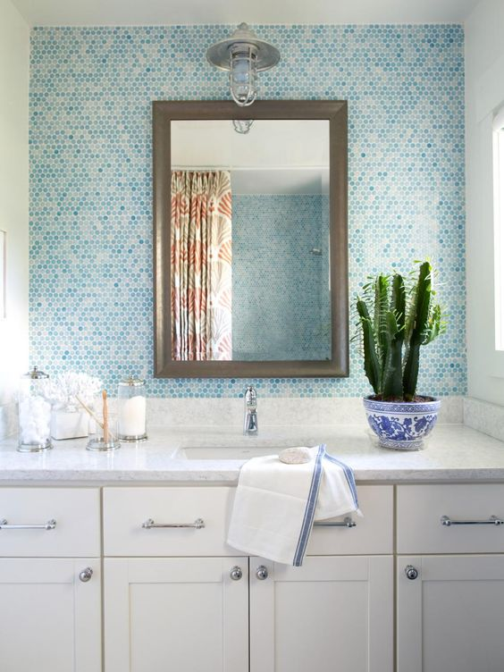 tiles in the shades of blue to give the bathroom a seaside touch