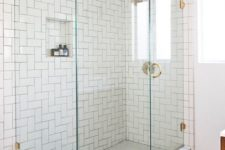 29 white subway tiles in the shower clad in straight herringbone pattern