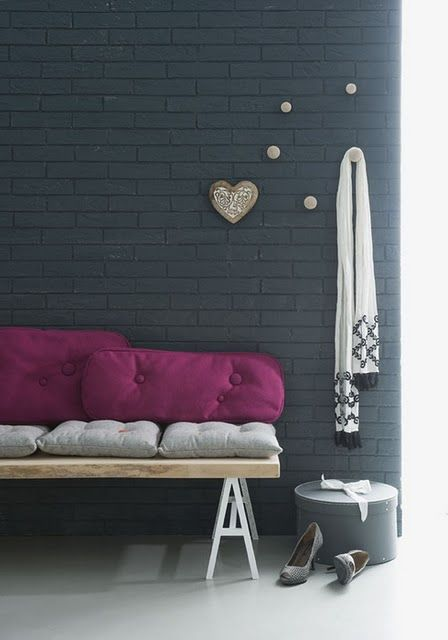 black brick wall made up with wall panels decorated with wooden pieces