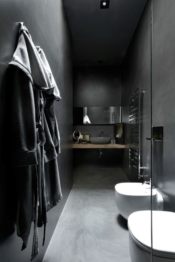narrow minimalist bathroom with tiled walls and floors