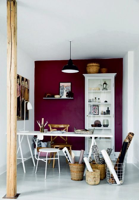 purple accent wall in a white craft room makes a bold statement