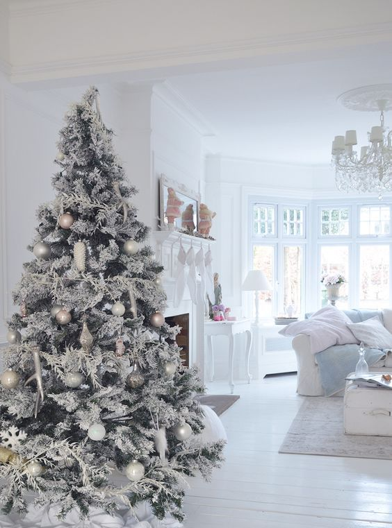 snowy Christmas tree with white and silver ornaments