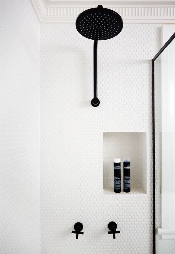 white penny tiles contrast with black fittings