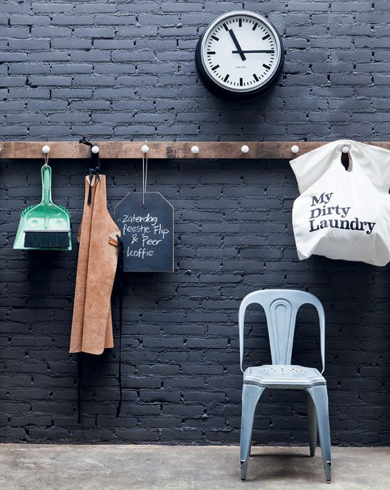 black brick wall with a wooden organizer and holder