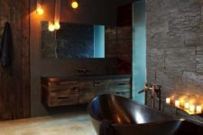 31 sexy masculine bathroom with a dark bathtub, dark tiles and wooden cabinets