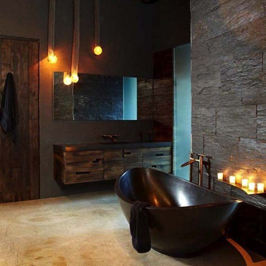 sexy masculine bathroom with a dark bathtub, dark tiles and wooden cabinets