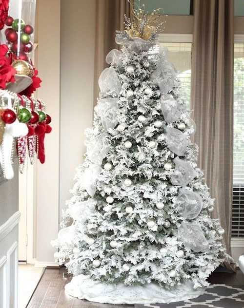 snowy tree with white ornaments and fabric garlands